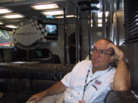 Jack Roush relaxes inside Mark Martin's hauler.